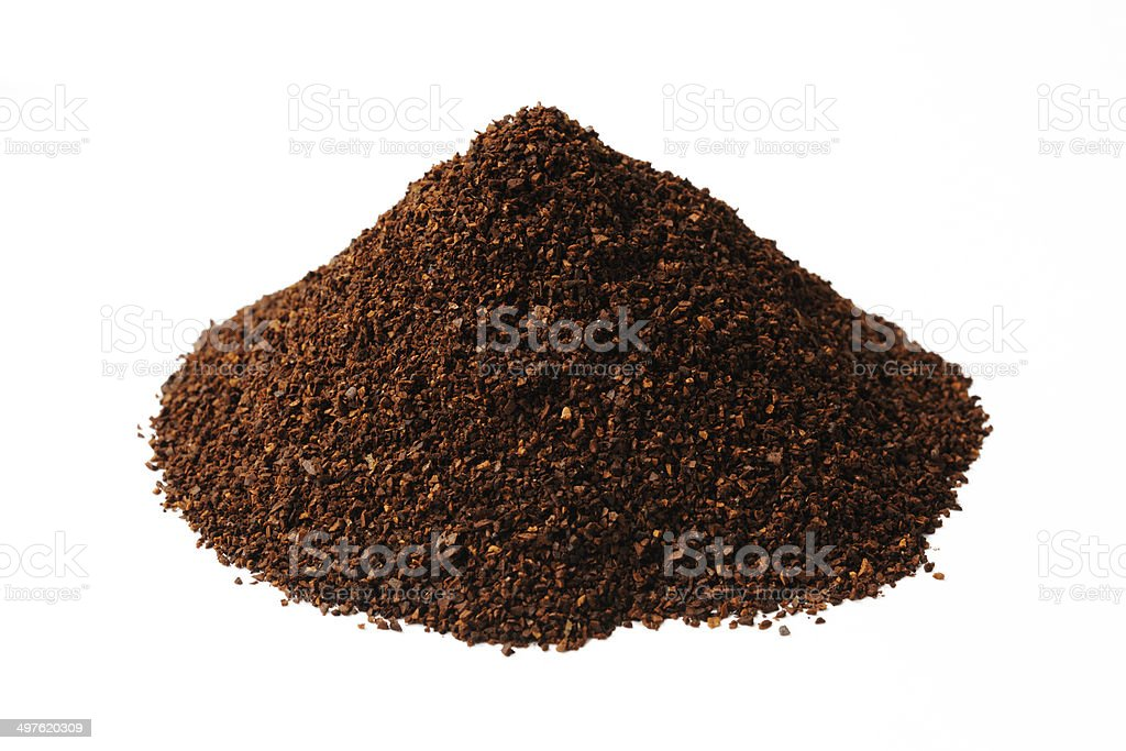 Isolated shot of stacked ground coffee beans on white background stock photo