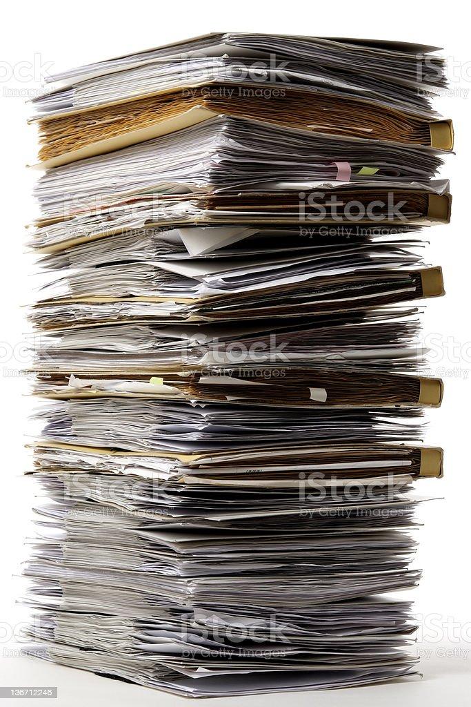 Isolated shot of stacked many documents on white background royalty-free stock photo