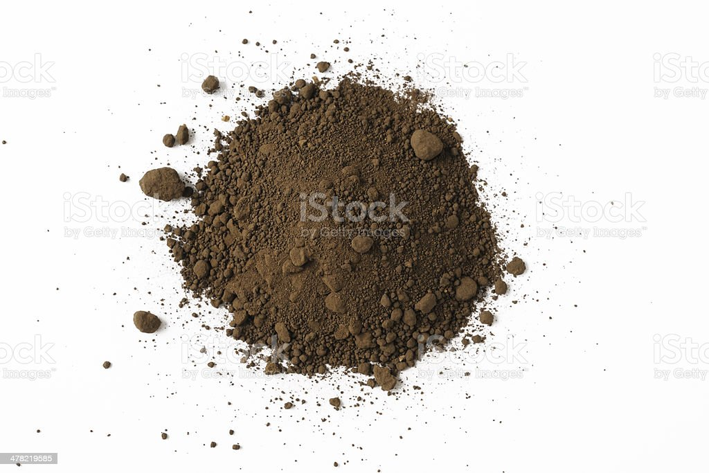 Isolated shot of stacked soil on white background stock photo