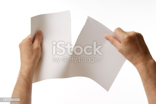 istock Isolated shot of tearing a blank paper against white background 137295005