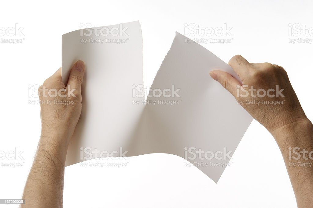 Isolated shot of tearing a blank paper against white background stock photo