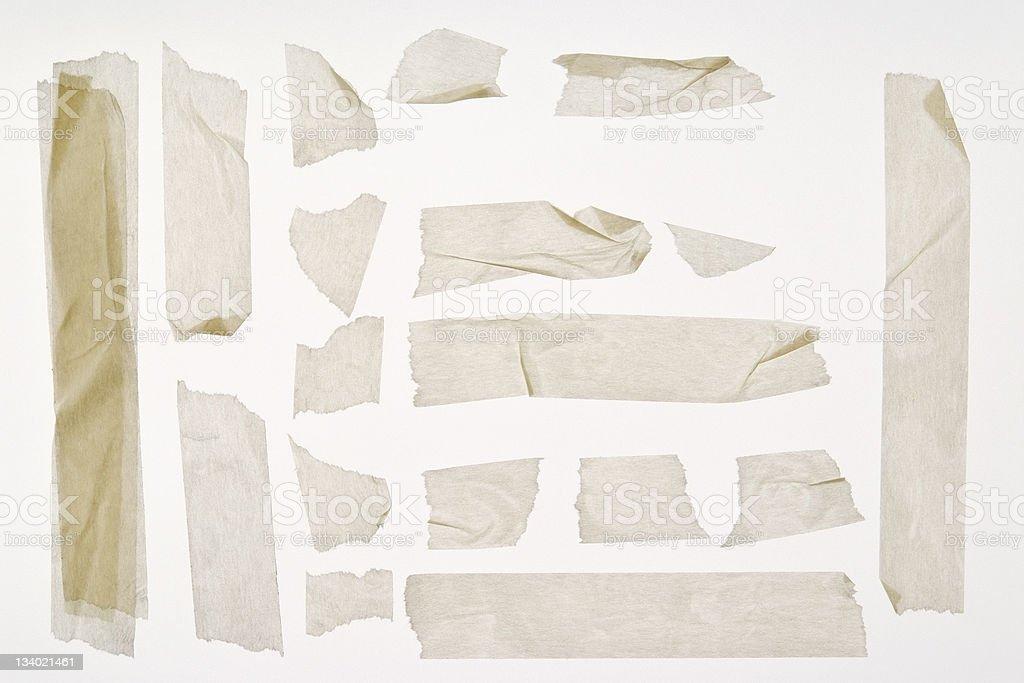 Isolated shot of torn adhesive masking tape on white background royalty-free stock photo