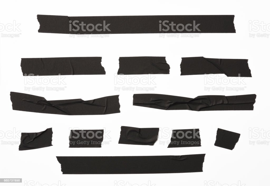 Isolated shot of torn black adhesive tape on white background - foto stock
