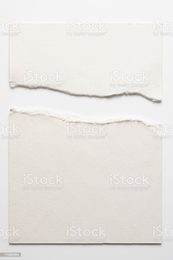 Isolated shot of torn blank white paper on white background stock photo