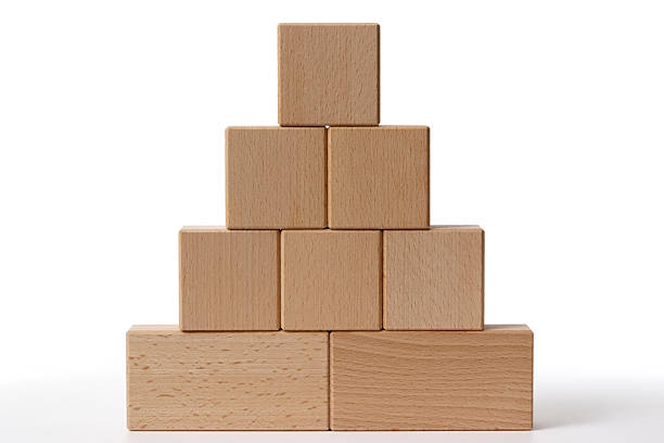 isolated shot of toy blocks on white background - pyramid stock photos and pictures