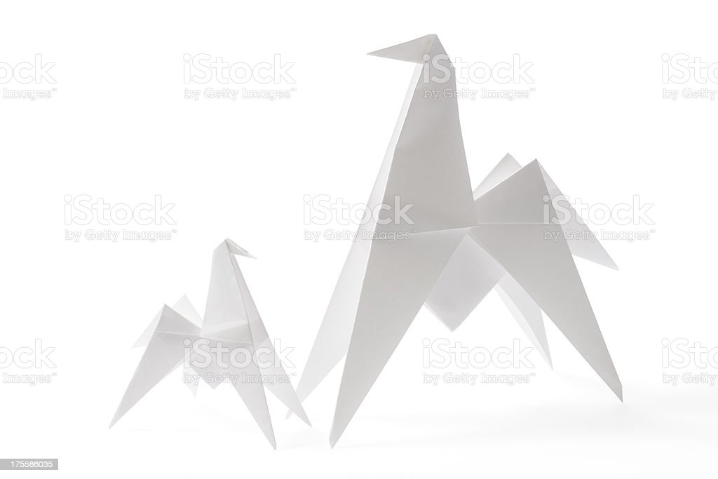 Isolated shot of two blank origami horse on white background stock photo