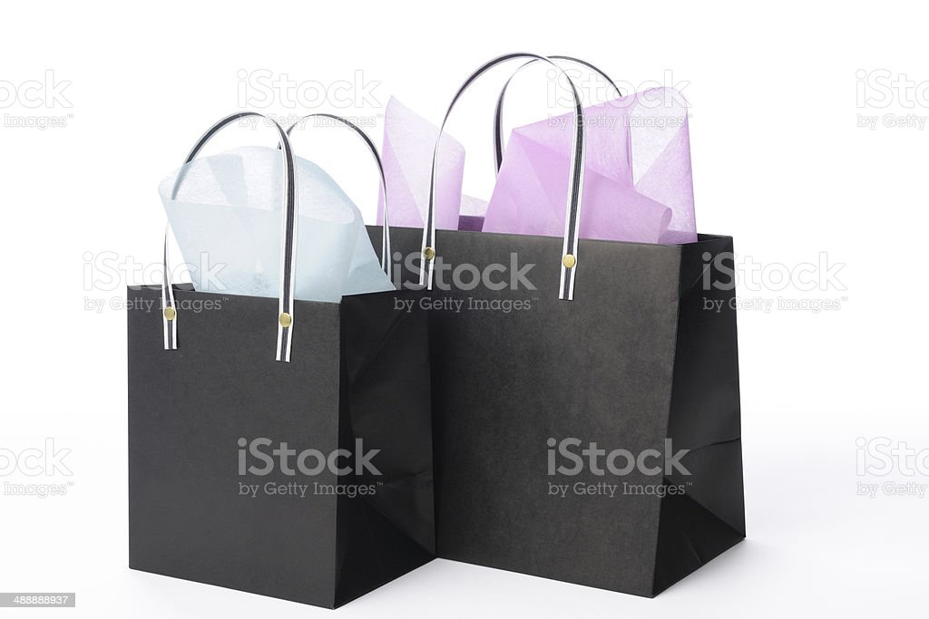 Isolated shot of two decorated black shopping bag on white stock photo
