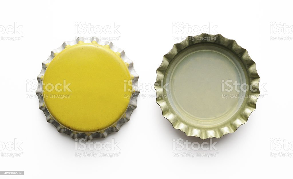 Isolated shot of two old bottle cap on white background stock photo