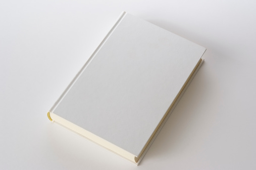 Isolated shot of white blank book on white background