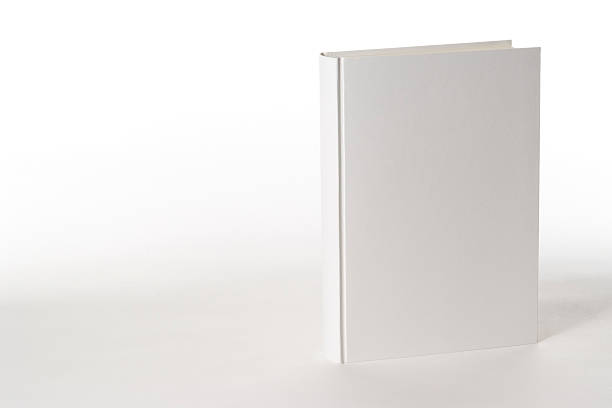Isolated shot of white blank book on white background White blank book on white background with copy space. hardcover book stock pictures, royalty-free photos & images