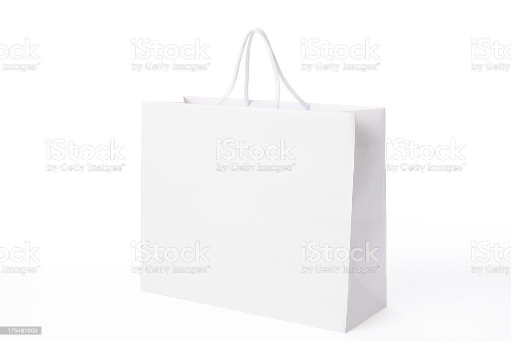 Isolated shot of white blank shopping bag on white background stock photo
