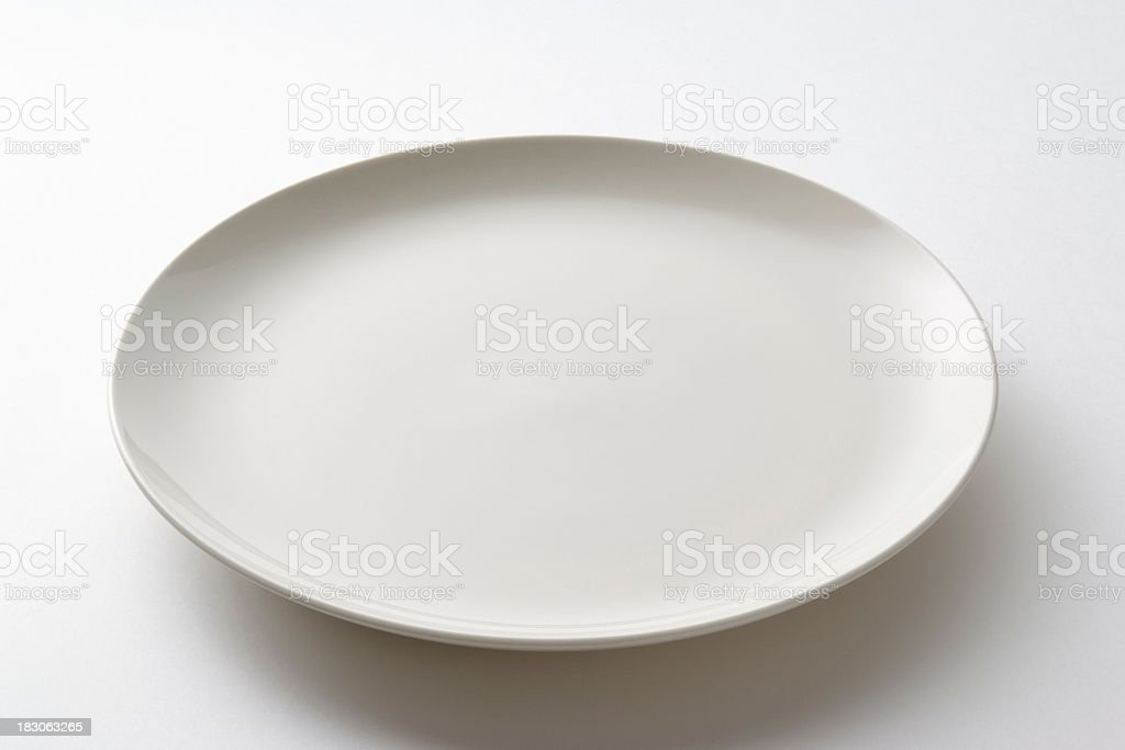 Isolated shot of white empty plate on white background stock photo
