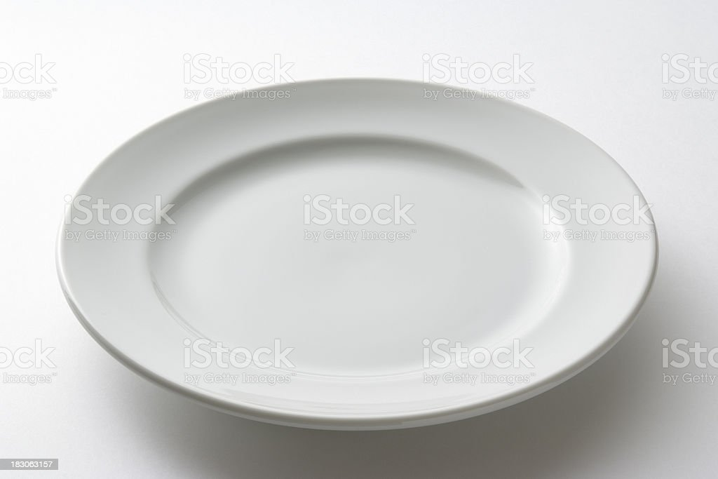 Isolated shot of white plate on white background royalty-free stock photo