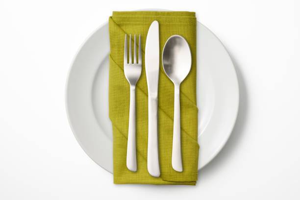 isolated shot of white plate with cutlery on white background - silverware stock pictures, royalty-free photos & images