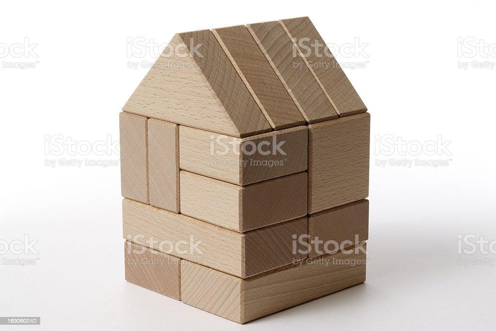 Isolated shot of wood block house on white background stock photo