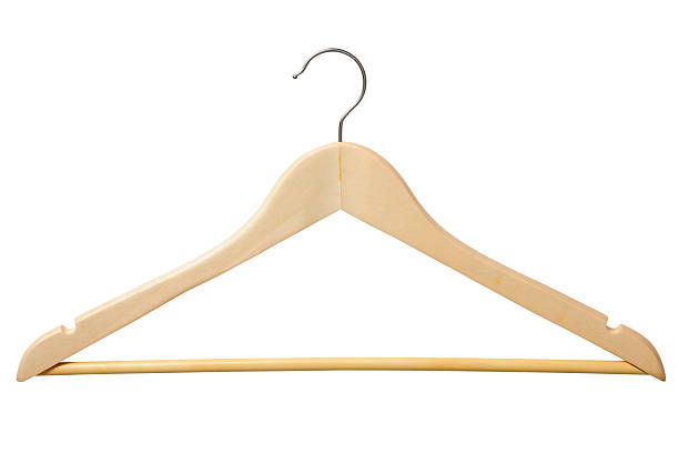 Isolated shot of wooden coat hanger on white background Wooden coat hanger isolated on white background with clipping path. coathanger stock pictures, royalty-free photos & images