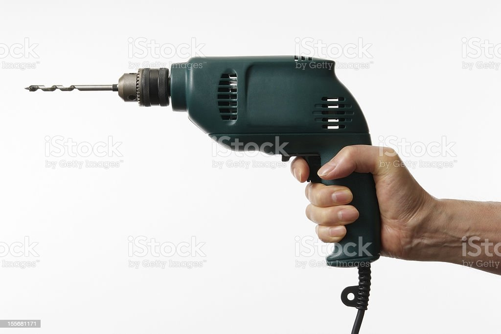 Isolated shot of working hand with electric drill on white royalty-free stock photo