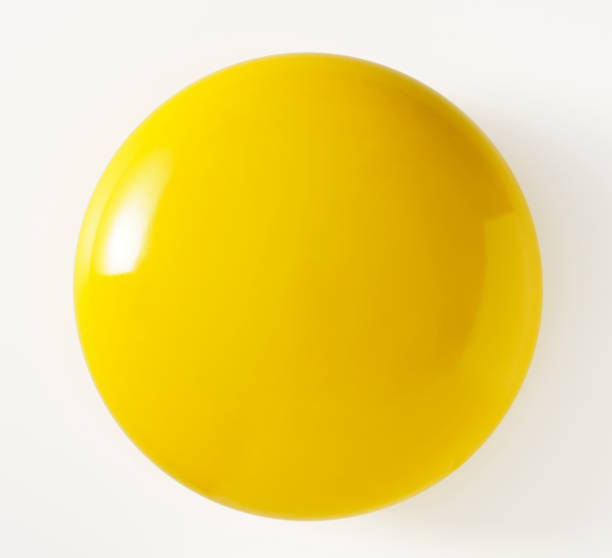 isolated shot of yellow metal can on white background - sphere stock pictures, royalty-free photos & images