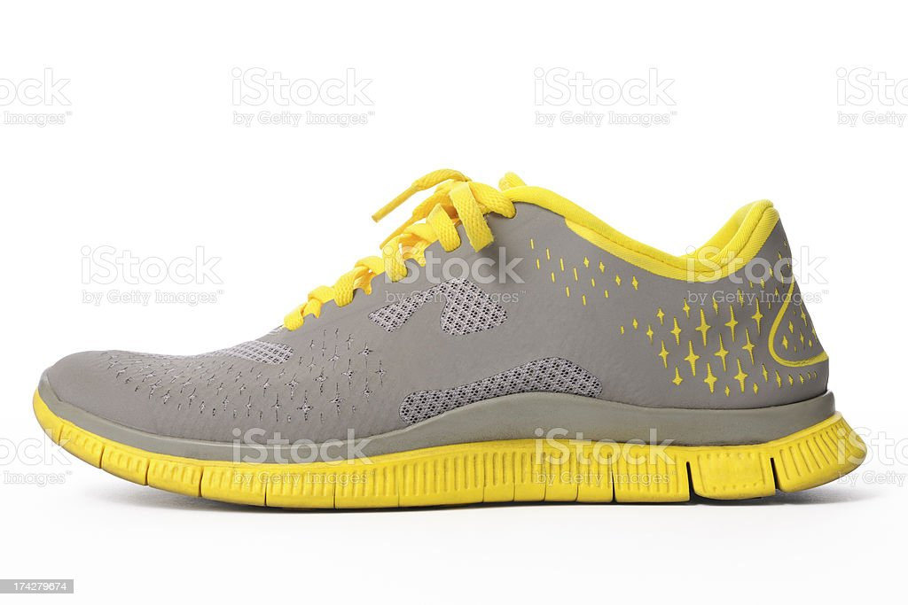 Isolated shot of yellow sneaker on white background stock photo