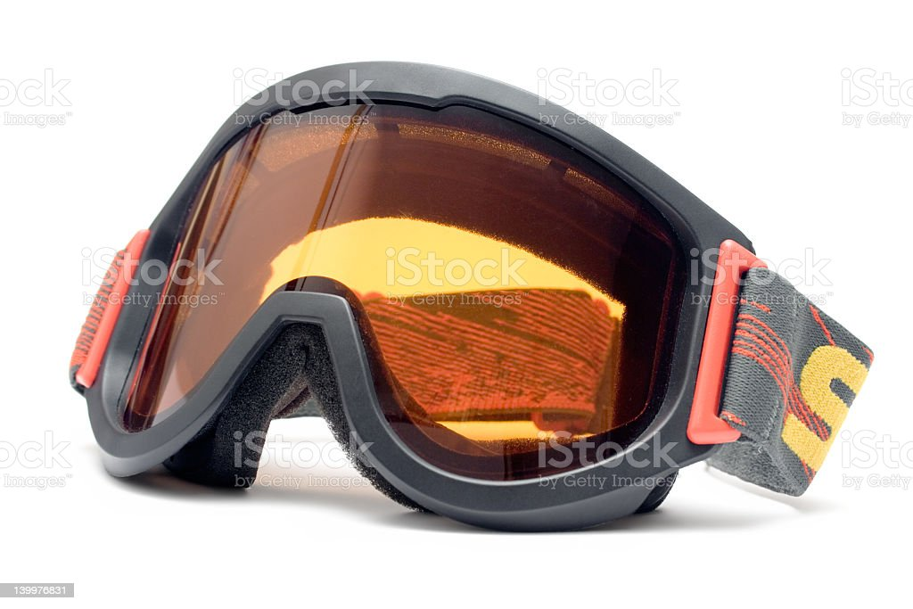 Isolated ski goggles with orange shade stock photo