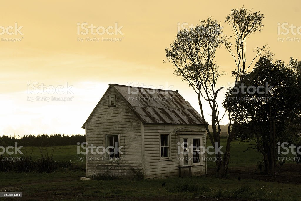 Isolated small dilapidated House stock photo