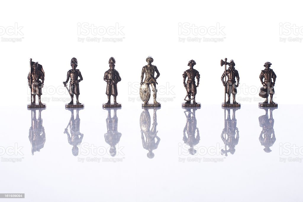 isolated small toy metal soldiers with reflection stock photo