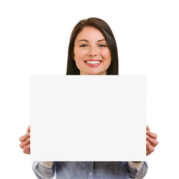 Isolierte lächelnd Junge Frau zeigt leere Schild – Foto