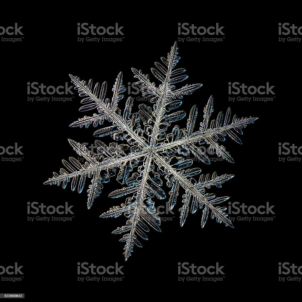 Isolated snowflake on black stock photo