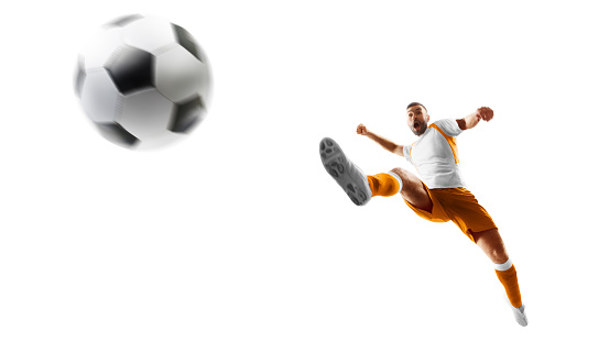 Isolated. Soccer kick. A soccer player kicks the ball in air fashion. Professional soccer player in action. Sport