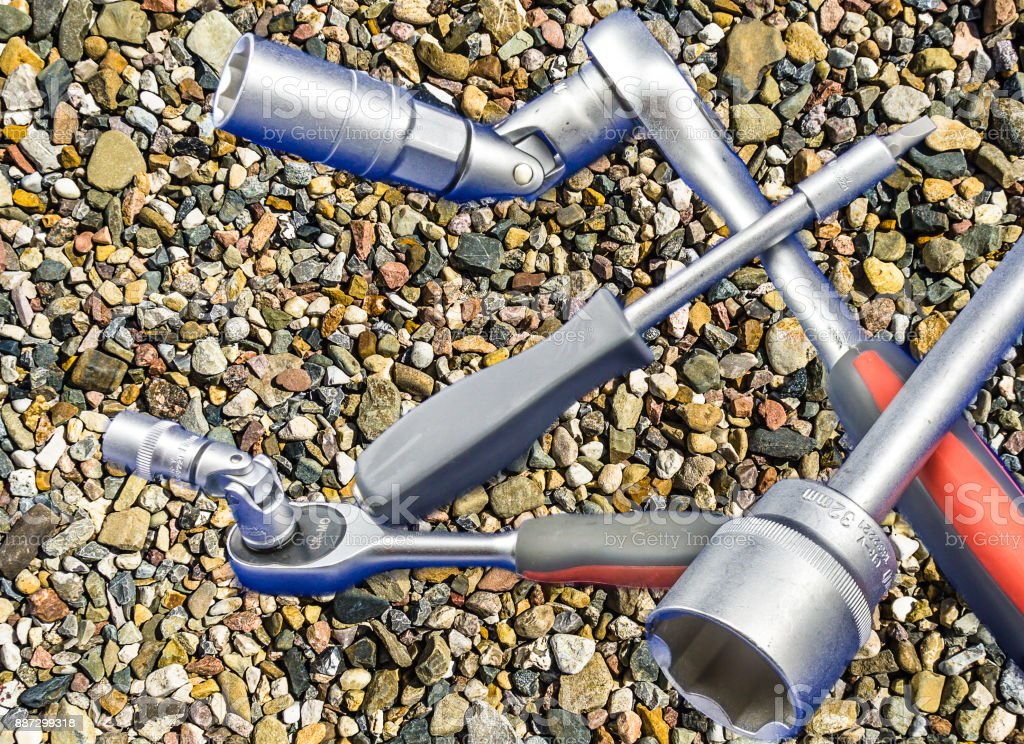 Isolated socket wrench set in front of a background of coloured gravel stock photo