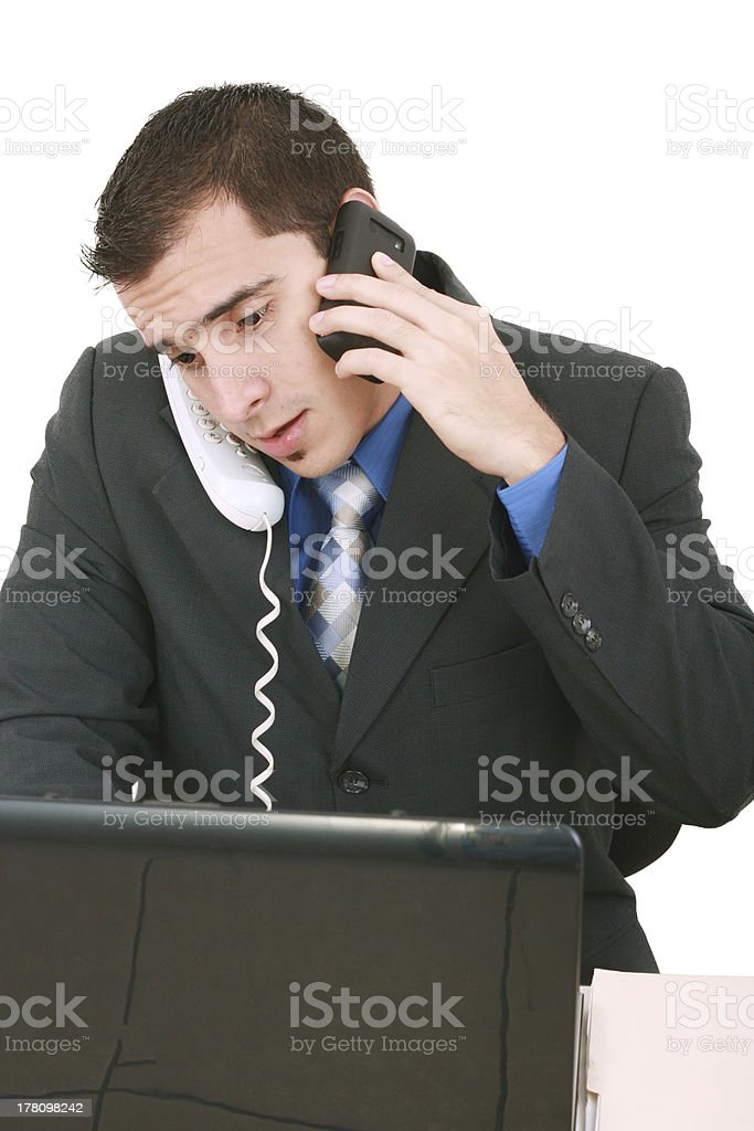 Isolated Stressed Businessman At His Desk Working royalty-free stock photo