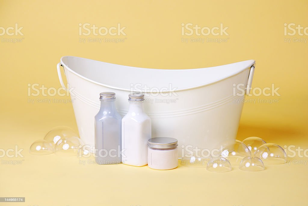 isolated studio shot of Baby Basin with soap and bubbles stock photo