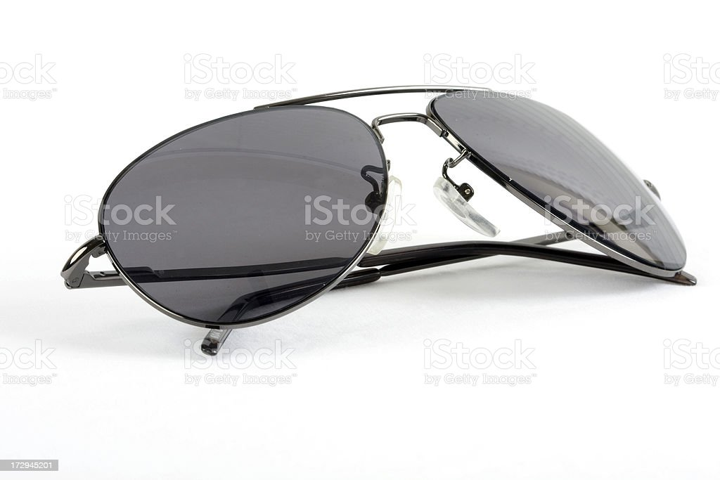 Isolated sunglasses with folded earpieces stock photo