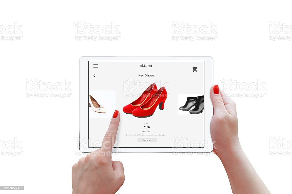 Isolated tablet and woman hands online shopping. Holding stock photo