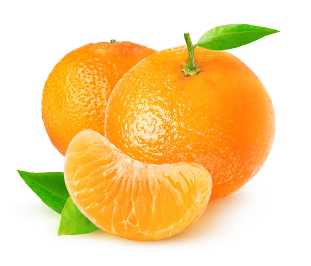 Isolated tangerines Isolated citrus fruits. Tangerines on white background with clipping path tangerine stock pictures, royalty-free photos & images