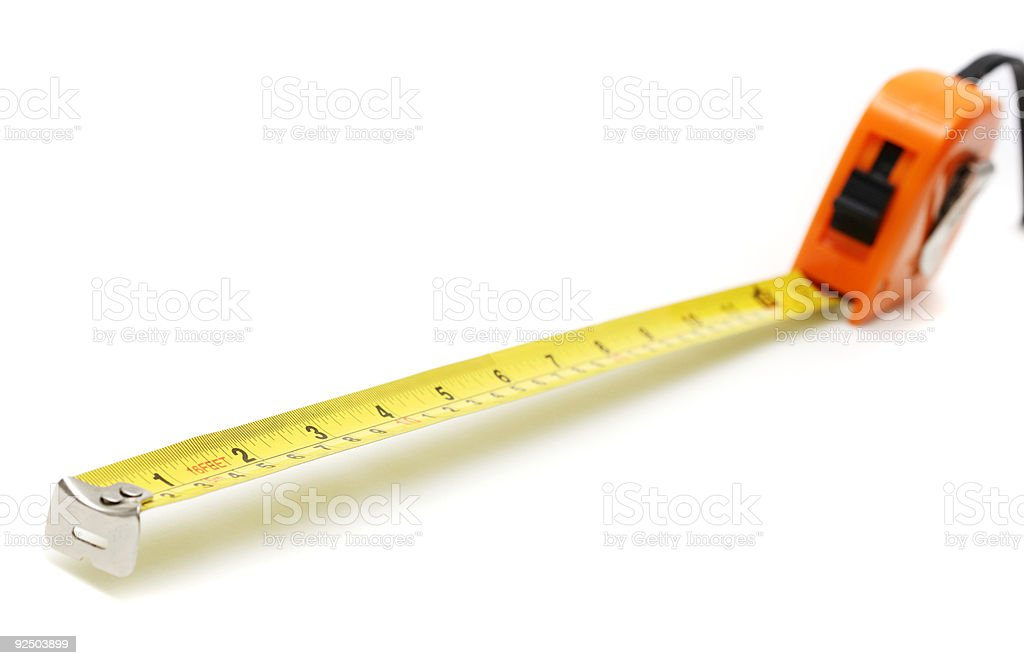 isolated tape measure extended against white royalty-free stock photo