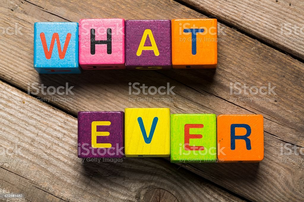 Isolated. The word What ever on a wooden toy blocks stock photo