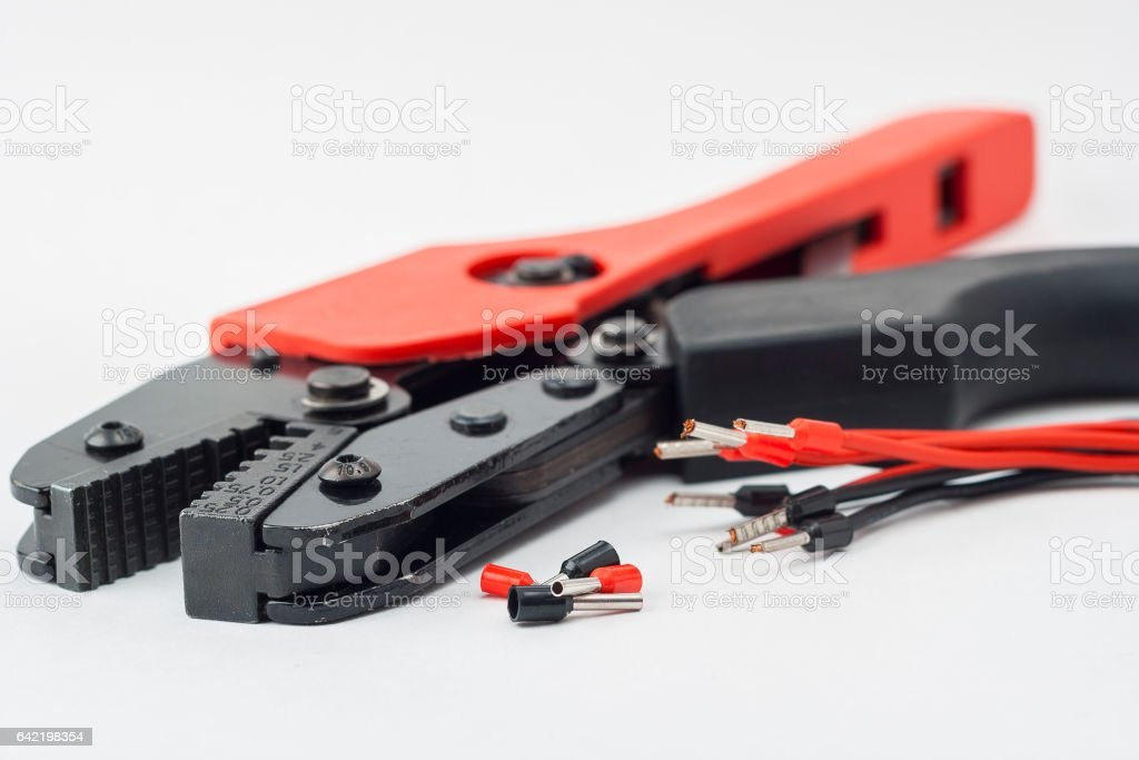 Isolated tool for crimping cable on a white background. stock photo