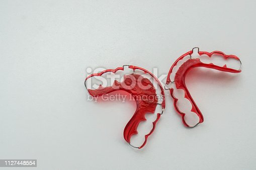 istock Isolated top view of red retainer for women health 1127448554