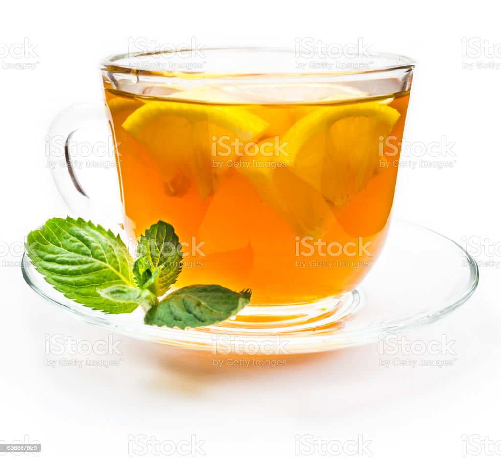 Isolated transparent cup of tea with lemon slice stock photo