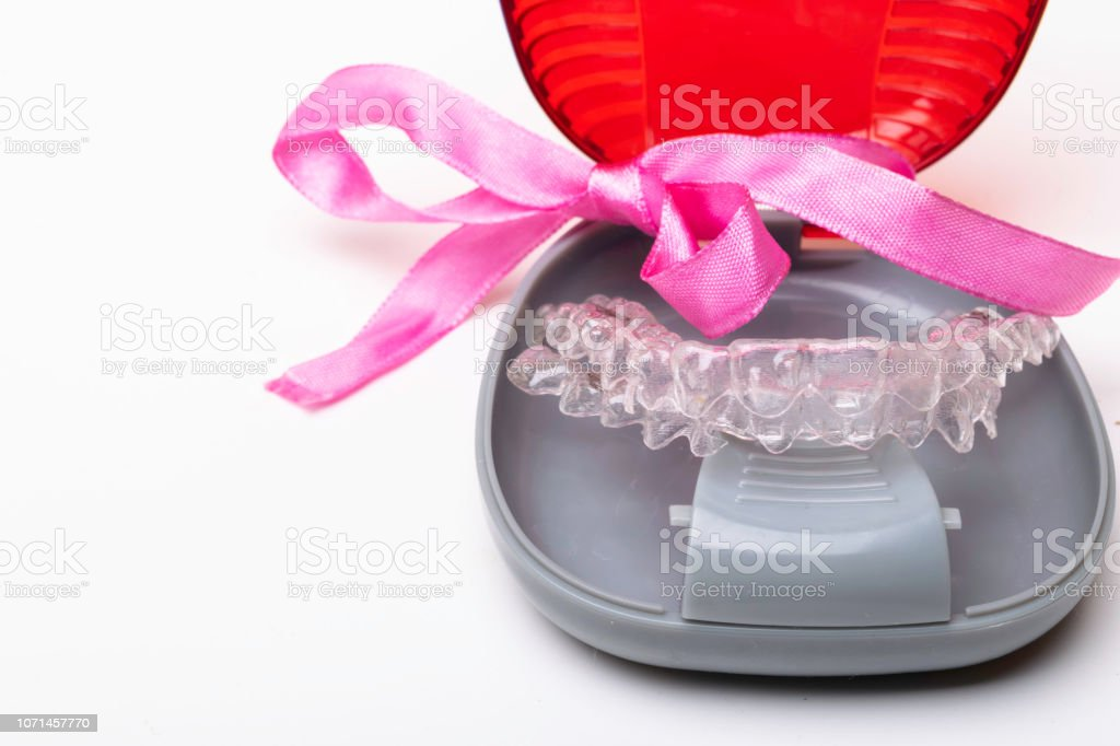 Isolated transparent teeth prosthesis aligner with its box, A way to...