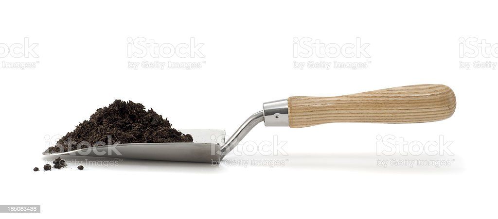 Isolated trowel with pile of compost stock photo