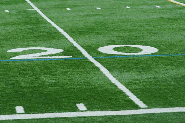 Isolated Twenty Yard Line on Football Field stock photo