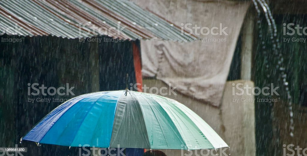 Isolated umbrella in the rain unique photo stock photo