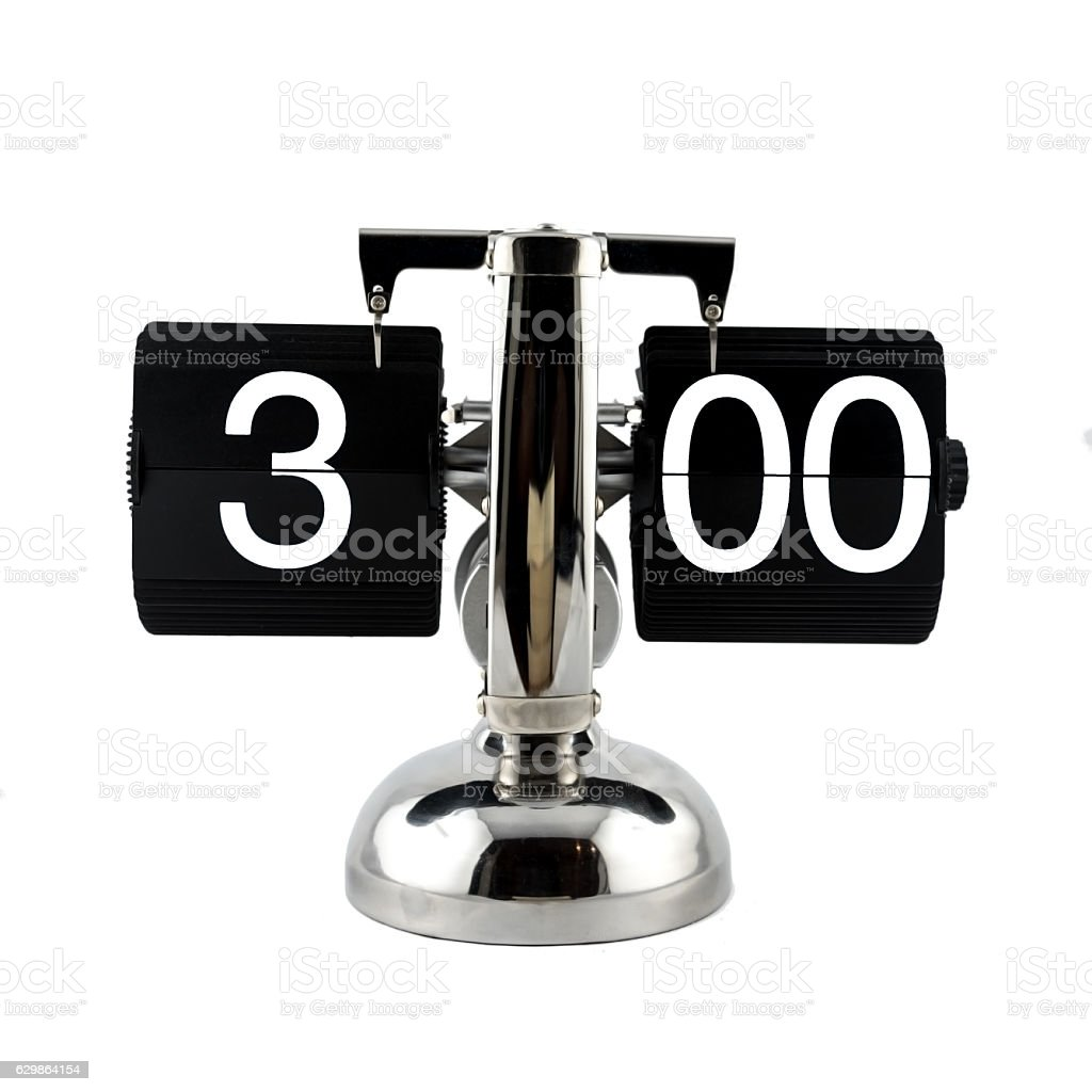 Isolated vintage flip clock on at three o'clock stock photo