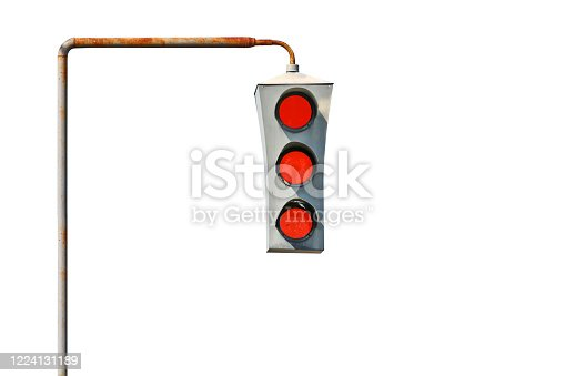 Isolated Vintage old traffic light on a rusty post. All lights are red. The concept of prohibition and bad luck.