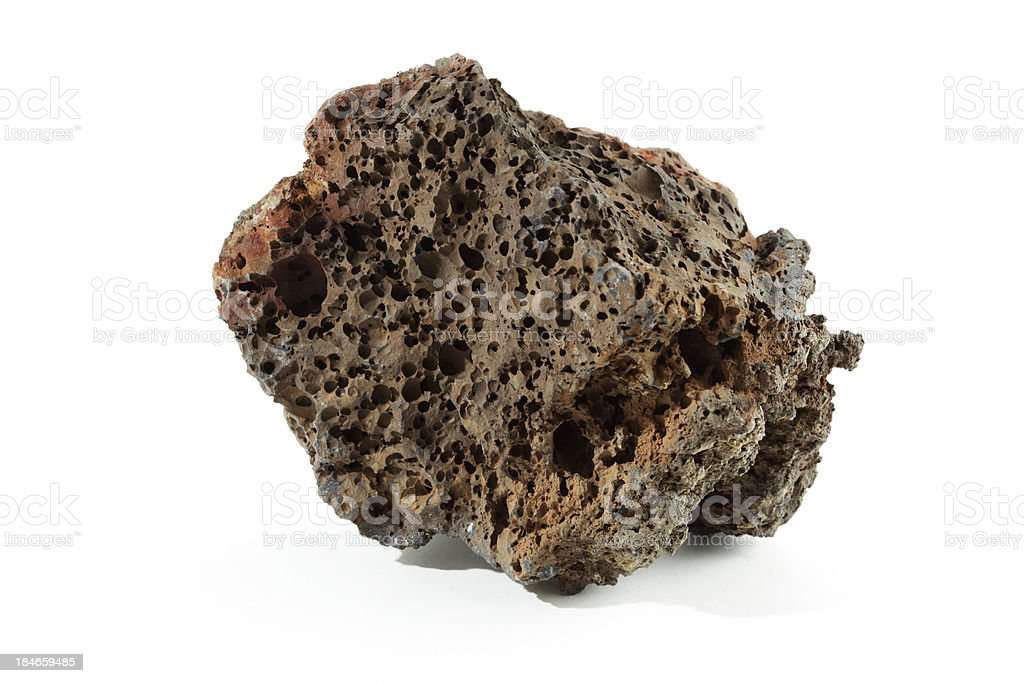 Isolated volcanic basalt lava with bubbles rock on white stock photo