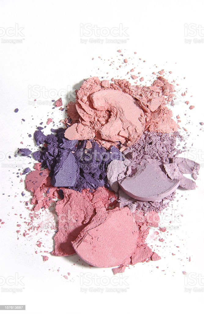 Isolated warm-toned makeup crushed into pieces stock photo