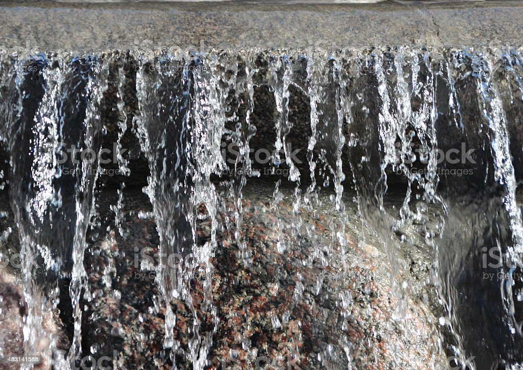 Isolated Waterfall from Flooded Rock Urban Fountain stock photo