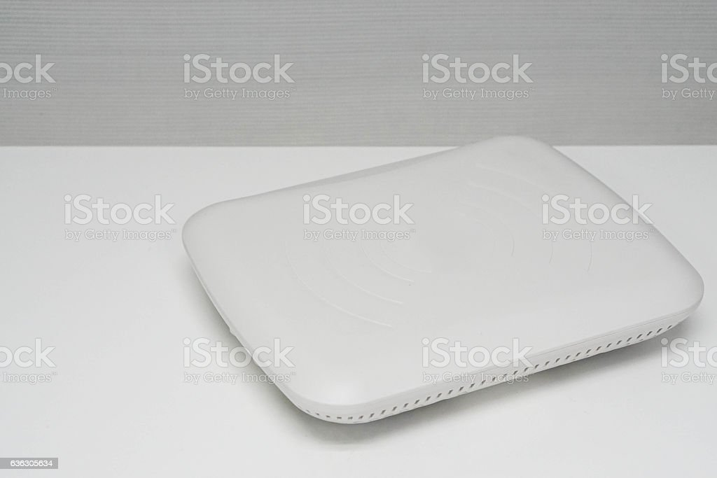 isolated white access point on office desk stock photo